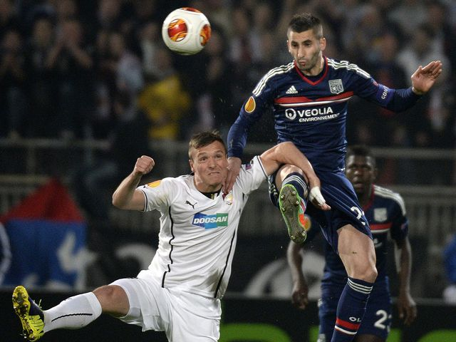 Lyon's Maxime Gonalon fights for the ball with Plzen's Stanislav Tecl