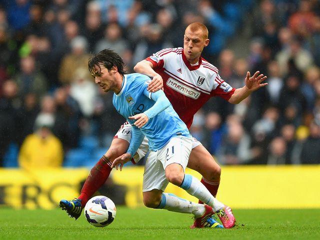 Steve Sidwell puts David Silva under pressure