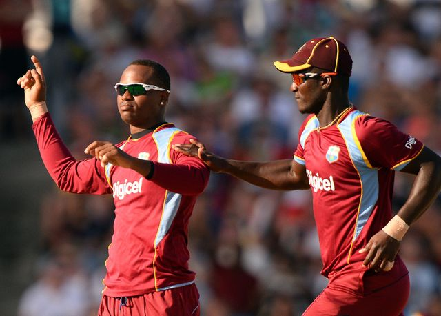 Marlon Samuels and Darren Sammy after taking Eoin Morgan's wicket