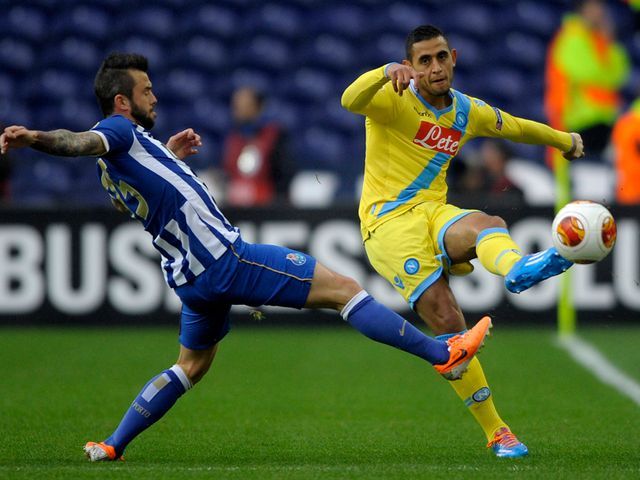 Napoli defender Faouzi Ghoulam vies with Steven Defour
