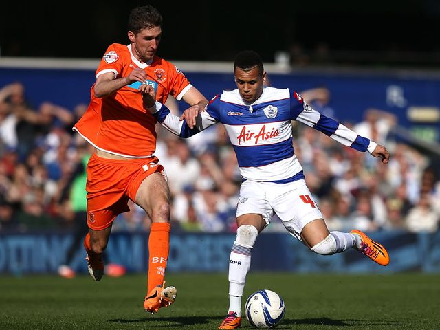 Chris Basham and Ravel Morrison battle for the ball