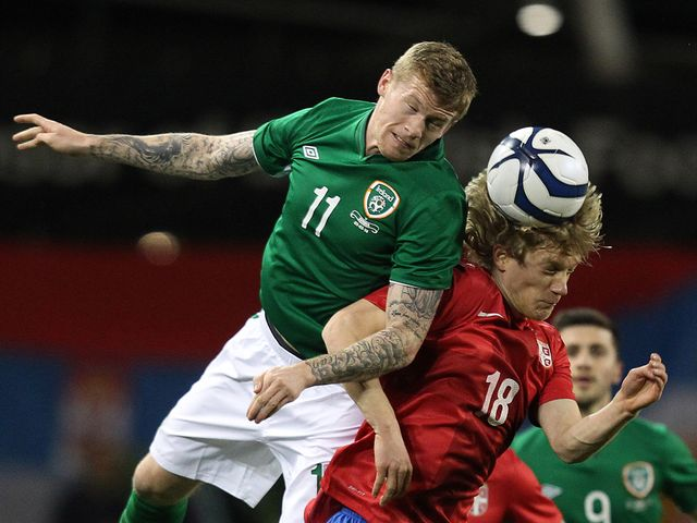 James McClean goes up for a header