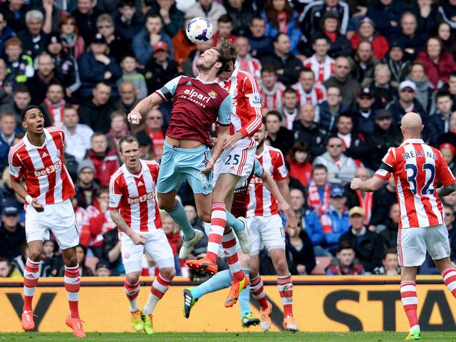Peter Crouch and Andy Carroll go for a high ball