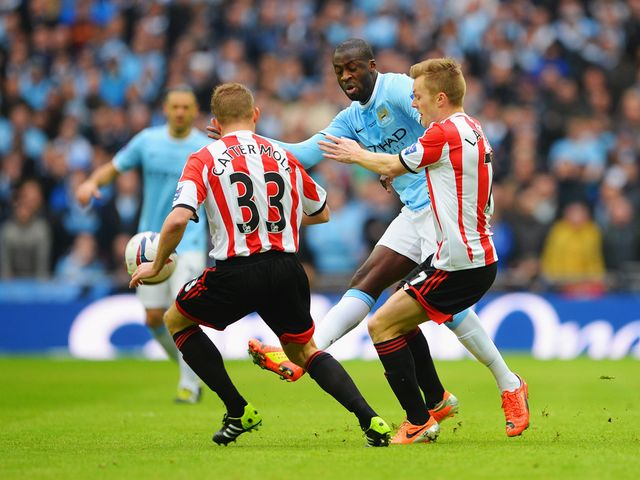 Yaya Toure is put under pressure