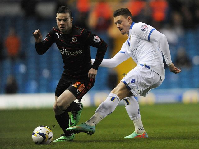 Danny Guthrie and Connor Wickham in action