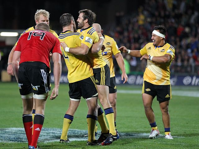 The Hurricanes celebrate against the Crusaders