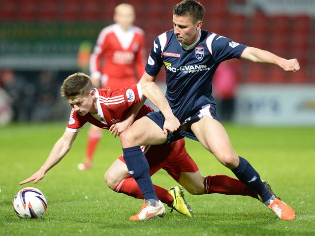 Aberdeen's Cammy Smith (left) is tackled by Filip Kiss