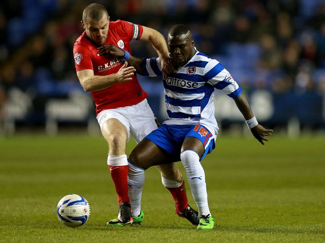 Reading's Royston Drenthe is tackled by Barnsley's Stephen Dawson