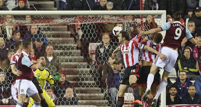 Andy Carroll: Leaps above John O'Shea to head West Ham into the lead