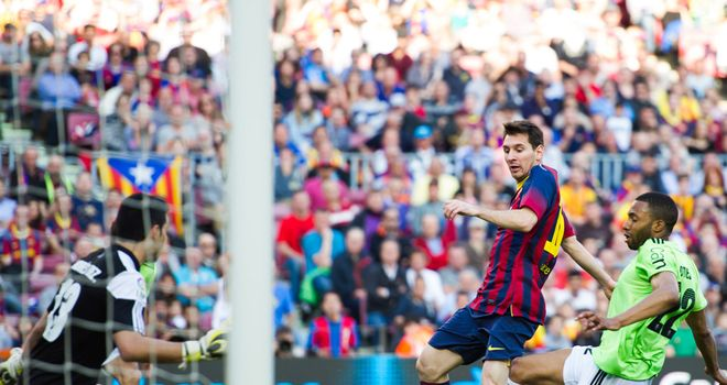 Lionel Messi opens the scoring