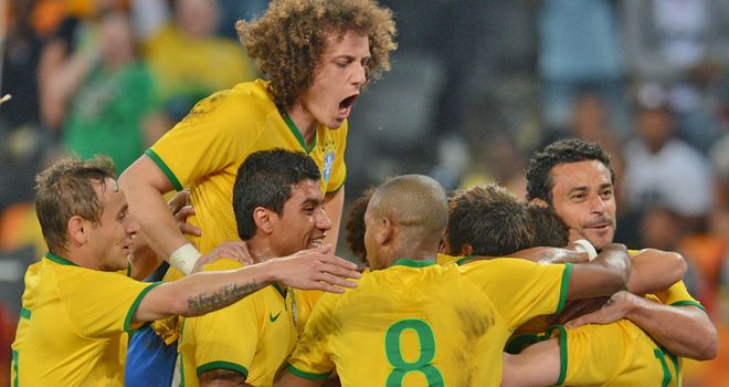 Neymar is mobbed after firing a treble against South Africa