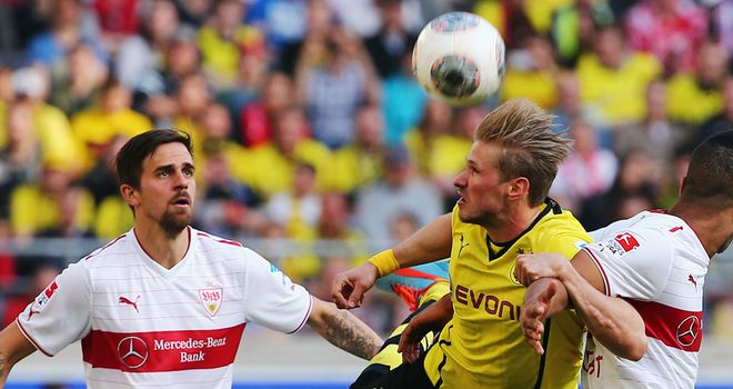 Oliver Kirch of Dortmund is challenged by Martin Harnik