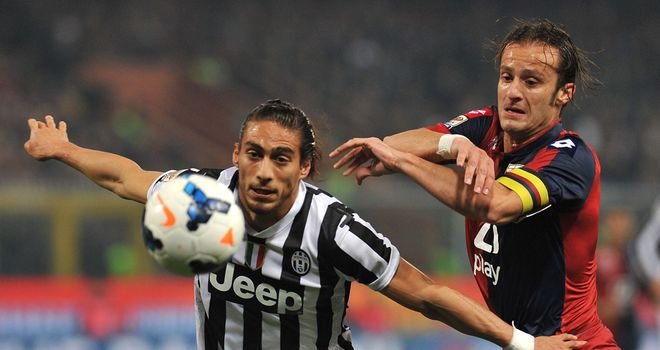 Martin Caceres stays ahead of Alberto Gilardino
