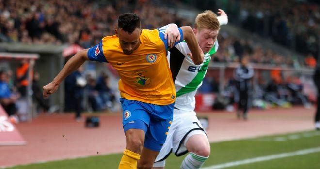 Karim Bellarabi holds off Kevin De Bruyne