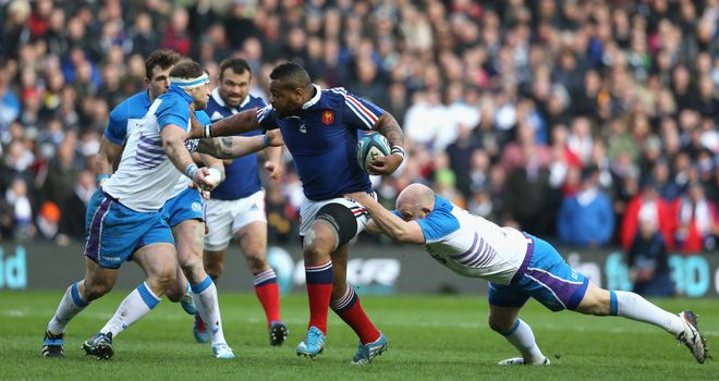 Mathieu Bastareaud makes a rampaging run for France