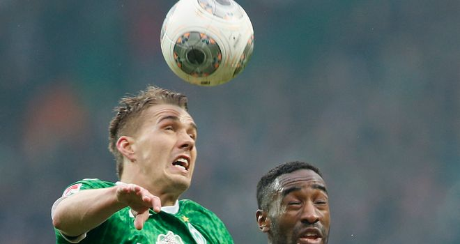 Nils Petersen and Johan Djourou battle for a high ball