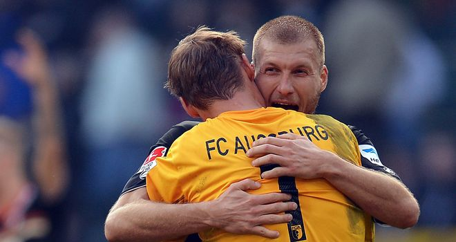 Ragnar Klavan and Alex Manninger celebrate Augburg's success