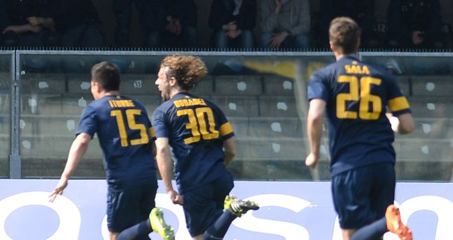 Marco Donadel of Verona celebrates after scoring
