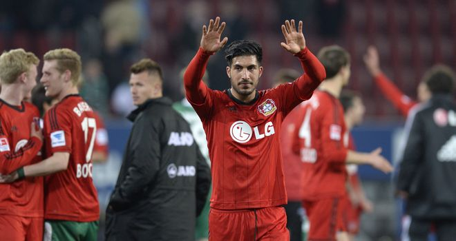 Leverkusen's midfielder Emre Can celebrates at full time