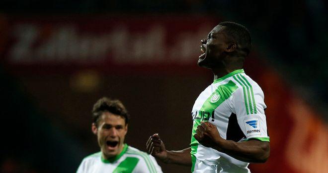 Junior Malanda of Wolfsburg celebrates after scoring his team's first goal