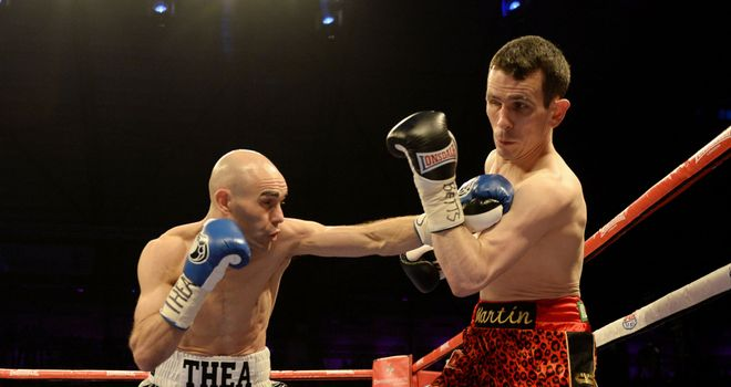 Hall lands a right on Ward in their March title clash