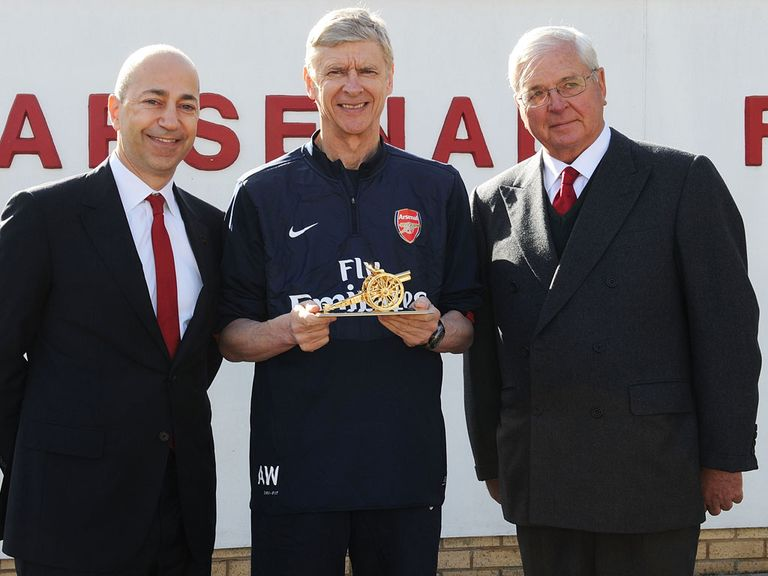 Arsene Wenger being presented with a gold cannon