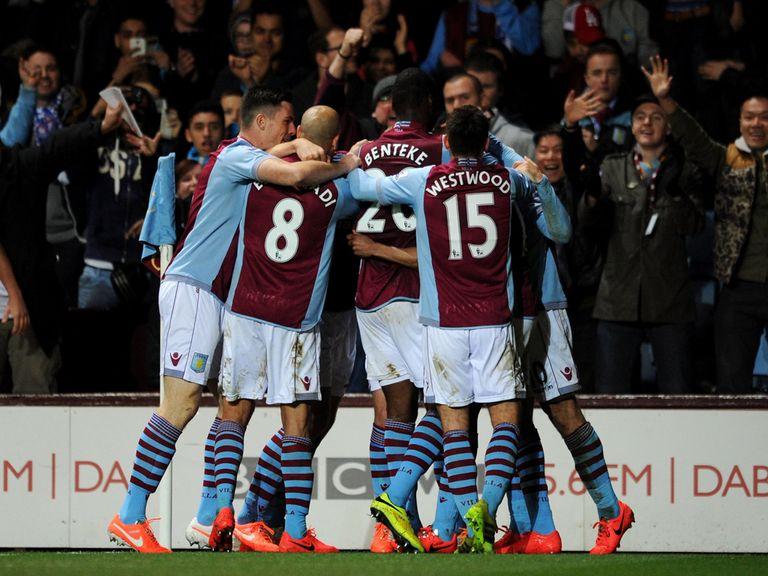 Aston Villa celebrate Fabian Delph's winning goal