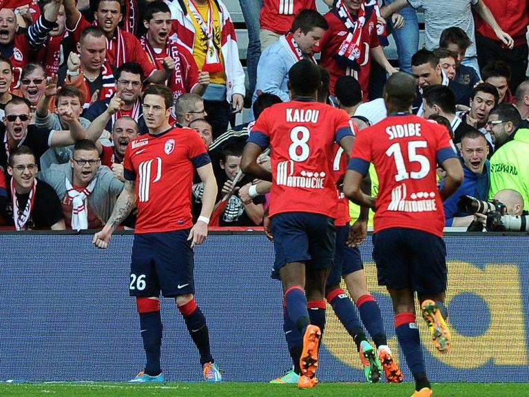 Lille's French forward Nolan Roux celebrates