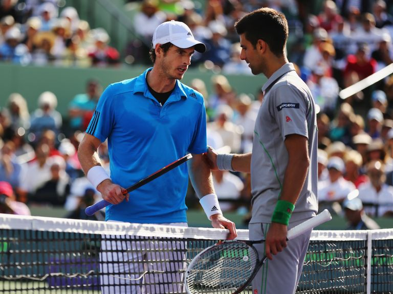 Murray (l) and Djokovic discuss the controversial first-set moment