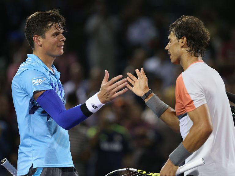 Rafael Nadal  shakes hands with Milos Raonic