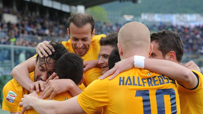 Luca Toni celebrates with his Verona team-mates