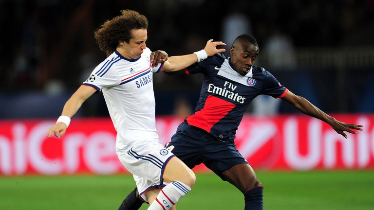 David Luiz (left) in action against the team he is set to join - PSG