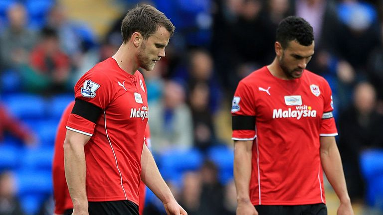 Steven Caulker (right) says Cardiff's players need to focus on their performances
