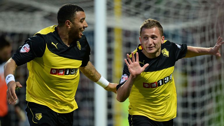 Almen Abdi (r): Celebrates the opener with fellow scorer Troy Deeney