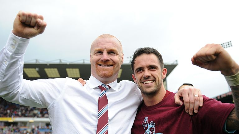 Burnley manager Sean Dyche (left) celebrates with Danny Ings