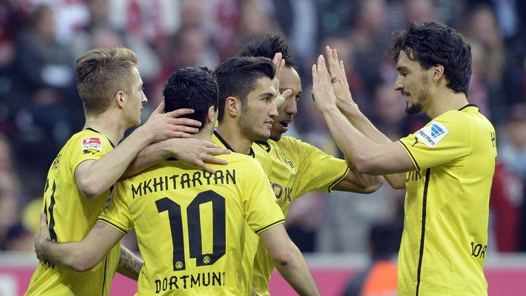 Henrikh Mkhitaryan: Celebrates Dortmund's opener at Bayern Munich