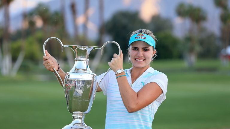 Lexi Thompson proudly holds the trophy after her  Kraft Nabisco Championship success