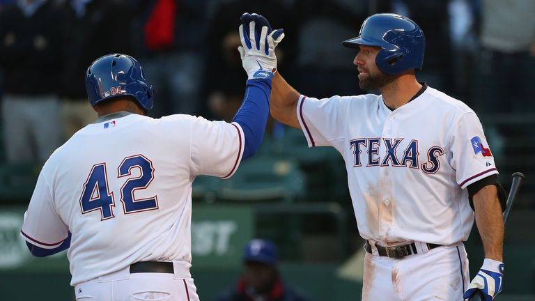 Prince Fielder (left): The Texas Ranger celebrates his homer with team-mate Kevin Kouzmanoff