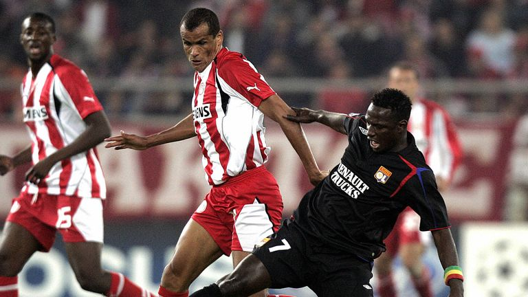 Rivaldo fights for the ball for Olympiakos as young team-mate Yaya Toure looks on