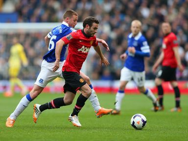Juan Mata and James McCarthy vie for possession