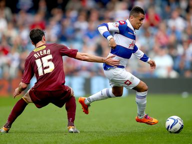 Ravel Morrison of QPR is challenged by Albert Riera of Watford