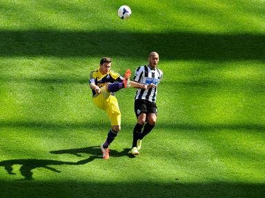 Swansea's Jordi Amat (left) and Newcastle's Yoan Gouffran