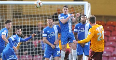Reach checks Posh play-off push