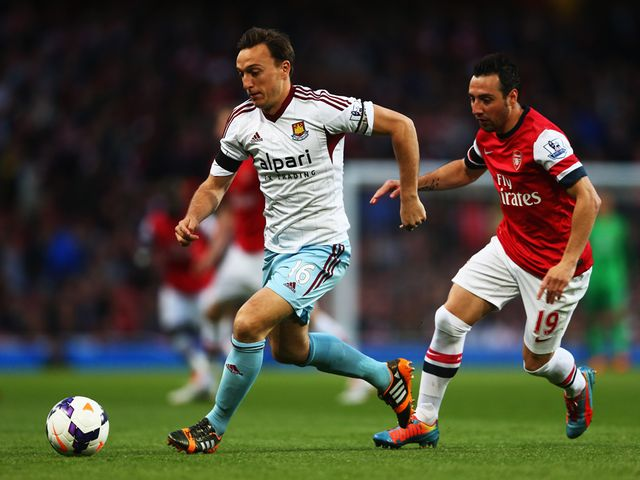 Mark Noble gets away from Santi Cazorla