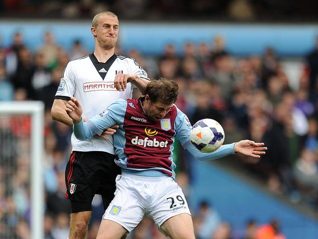Grant Holt is put under pressure by Brede Hangeland