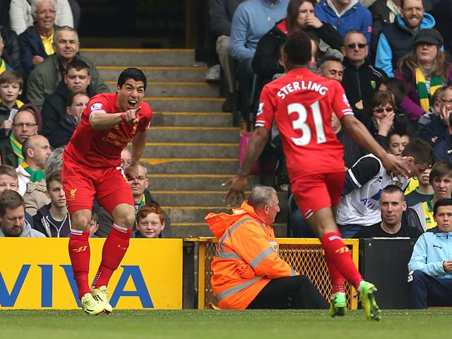 Luis Suarez celebrates with Raheem Sterling