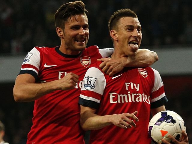 Giroud and Koscielny celebrate on Monday
