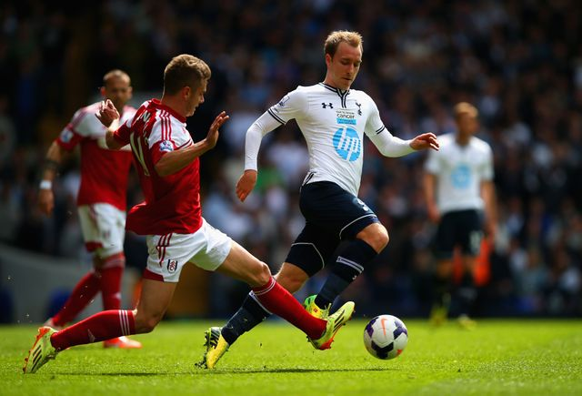 Alex Kacaniklic of Fulham attempts to tackle Christian Eriksen of Tottenham