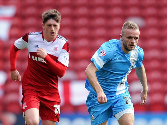 Adam Reach of Middlesbrough chases Ryan McLaughlin of Barnsley
