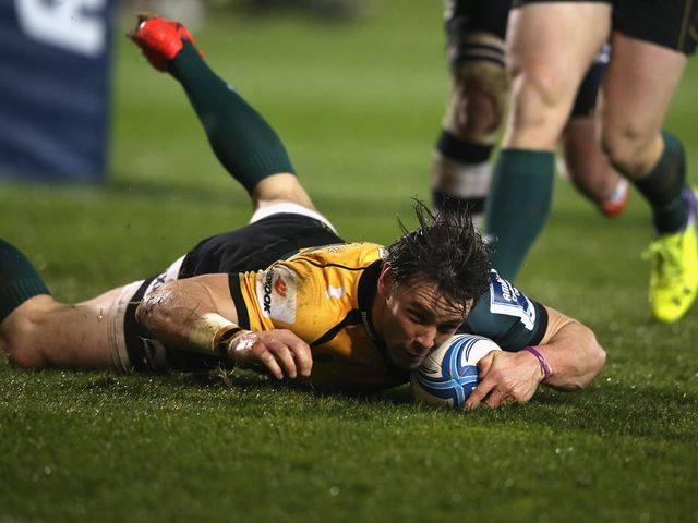 Ben Foden of Northampton dives over for a try